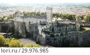 Купить «Aerial view of ruined medieval castle of Chateau de Beaucaire on background of French commune of Beaucaire», видеоролик № 29976985, снято 24 октября 2018 г. (c) Яков Филимонов / Фотобанк Лори