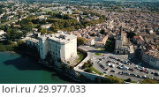 Купить «Aerial view of medieval fortified Chateau de Tarascon and Rhone river at sunny day», видеоролик № 29977033, снято 24 октября 2018 г. (c) Яков Филимонов / Фотобанк Лори