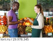 Купить «client is asking from seller female about freshness oranges», фото № 29978345, снято 26 мая 2018 г. (c) Яков Филимонов / Фотобанк Лори
