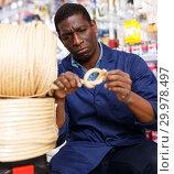 Купить «seller organizing assortment of items on shelves and racks», фото № 29978497, снято 21 января 2019 г. (c) Яков Филимонов / Фотобанк Лори