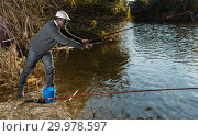 Купить «Man fishing with rods», фото № 29978597, снято 27 января 2019 г. (c) Яков Филимонов / Фотобанк Лори