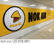 Купить «Nok Air sign in Don Mueang International airport, Bangkok», фото № 29978981, снято 6 сентября 2018 г. (c) Александр Подшивалов / Фотобанк Лори