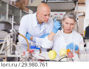 Купить «Genetic scientists working in laboratory», фото № 29980761, снято 24 января 2019 г. (c) Яков Филимонов / Фотобанк Лори
