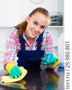 Купить «girl cleaning table with cloth», фото № 29980801, снято 19 февраля 2019 г. (c) Яков Филимонов / Фотобанк Лори