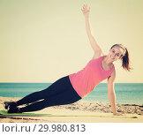 Купить «Woman doing yoga at beach», фото № 29980813, снято 19 февраля 2019 г. (c) Яков Филимонов / Фотобанк Лори
