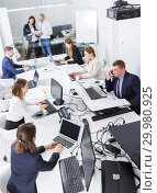 Купить «Above view of group of business people during daily work», фото № 29980925, снято 21 апреля 2018 г. (c) Яков Филимонов / Фотобанк Лори