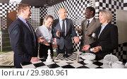 Купить «Smiling businesspeople solving together conundrums», фото № 29980961, снято 29 января 2019 г. (c) Яков Филимонов / Фотобанк Лори