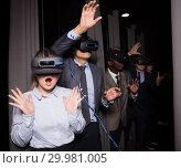 Купить «Happy girl wearing VR glasses», фото № 29981005, снято 29 января 2019 г. (c) Яков Филимонов / Фотобанк Лори
