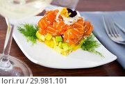Купить «Cube of delicious salmon tartare garnish with avocado on plate at cafe», фото № 29981101, снято 19 апреля 2019 г. (c) Яков Филимонов / Фотобанк Лори