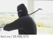 Купить «Burglar swinging crow bar», фото № 29996573, снято 29 июня 2012 г. (c) Wavebreak Media / Фотобанк Лори