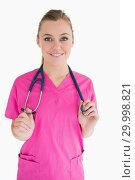 Купить «Happy woman wearing pink scrubs», фото № 29998821, снято 31 июля 2012 г. (c) Wavebreak Media / Фотобанк Лори