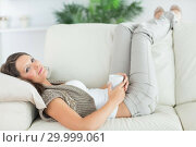 Купить «Calm woman lying on the sofa», фото № 29999061, снято 16 августа 2012 г. (c) Wavebreak Media / Фотобанк Лори