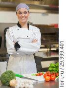 Купить «Smiling chef folding her arms beside vegetables », фото № 29999401, снято 1 августа 2012 г. (c) Wavebreak Media / Фотобанк Лори