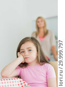 Купить «Little girl looking annoyed», фото № 29999797, снято 14 августа 2012 г. (c) Wavebreak Media / Фотобанк Лори