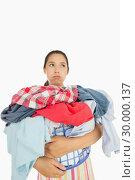 Купить «Overworked woman holding basket full of laundry », фото № 30000137, снято 8 августа 2012 г. (c) Wavebreak Media / Фотобанк Лори
