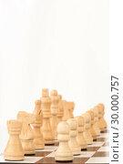 Купить «White chess pieces standing at the chessboard», фото № 30000757, снято 28 февраля 2012 г. (c) Wavebreak Media / Фотобанк Лори