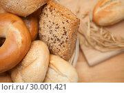 Купить «Bread in the basket with a roll on a wooden board», фото № 30001421, снято 31 января 2012 г. (c) Wavebreak Media / Фотобанк Лори
