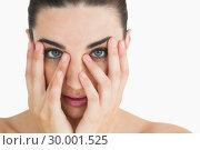 Купить «Pale woman touching her face», фото № 30001525, снято 27 августа 2012 г. (c) Wavebreak Media / Фотобанк Лори