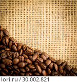 Купить «Burlap sack and pile of coffee beans», фото № 30002821, снято 28 февраля 2013 г. (c) Wavebreak Media / Фотобанк Лори