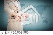 Купить «Businesswoman touching house graphic», фото № 30002985, снято 26 июня 2013 г. (c) Wavebreak Media / Фотобанк Лори