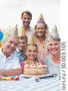 Happy extended family at birthday party. Стоковое фото, агентство Wavebreak Media / Фотобанк Лори