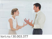 Купить «Angry business team having heated argument», фото № 30003377, снято 14 марта 2013 г. (c) Wavebreak Media / Фотобанк Лори