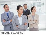 Stern work team crossing arms and looking away. Стоковое фото, агентство Wavebreak Media / Фотобанк Лори