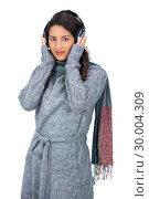 Купить «Beautiful model wearing winter clothes listening to music», фото № 30004309, снято 17 апреля 2013 г. (c) Wavebreak Media / Фотобанк Лори