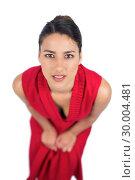 Купить «Mysterious brunette in red dress posing», фото № 30004481, снято 17 апреля 2013 г. (c) Wavebreak Media / Фотобанк Лори