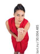 Купить «Mysterious brunette in red dress sending a kiss to camera», фото № 30004485, снято 17 апреля 2013 г. (c) Wavebreak Media / Фотобанк Лори