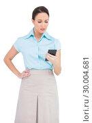 Купить «Worried classy businesswoman looking at her calculator», фото № 30004681, снято 22 апреля 2013 г. (c) Wavebreak Media / Фотобанк Лори