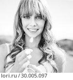Купить «Black and white photograph of cheerful sexy blonde», фото № 30005097, снято 26 апреля 2013 г. (c) Wavebreak Media / Фотобанк Лори