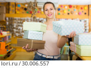 Купить «Smiling girl purchase of gift boxes», фото № 30006557, снято 19 апреля 2017 г. (c) Яков Филимонов / Фотобанк Лори