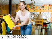 Купить «Woman demonstrates multi colored bags», фото № 30006561, снято 19 апреля 2017 г. (c) Яков Филимонов / Фотобанк Лори