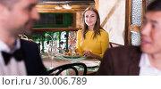 Купить «Woman is dining alone and carried away of talk two men», фото № 30006789, снято 8 марта 2018 г. (c) Яков Филимонов / Фотобанк Лори