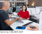 Купить «Consultant helping woman choosing upholstery fabric», фото № 30007037, снято 29 октября 2018 г. (c) Яков Филимонов / Фотобанк Лори