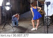 Купить «Photographer taking pictures of cheerful woman», фото № 30007377, снято 5 октября 2018 г. (c) Яков Филимонов / Фотобанк Лори