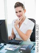 Купить «Smiling businesswoman working on computer», фото № 30008237, снято 5 июня 2013 г. (c) Wavebreak Media / Фотобанк Лори