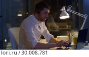 Купить «businessman in headset with laptop at night office», видеоролик № 30008781, снято 11 февраля 2019 г. (c) Syda Productions / Фотобанк Лори