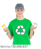 Dynamic pretty environmental activist holding two jars. Стоковое фото, агентство Wavebreak Media / Фотобанк Лори