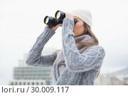 Купить «Pretty woman with winter clothes on looking through binoculars», фото № 30009117, снято 22 мая 2013 г. (c) Wavebreak Media / Фотобанк Лори