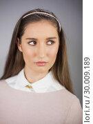 Купить «Close up on thoughtful pretty model posing», фото № 30009189, снято 22 мая 2013 г. (c) Wavebreak Media / Фотобанк Лори