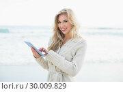 Купить «Cheerful blonde woman in wool cardigan using a tablet pc», фото № 30009829, снято 6 июня 2013 г. (c) Wavebreak Media / Фотобанк Лори