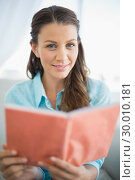Купить «Peaceful woman sitting on sofa reading book», фото № 30010181, снято 9 мая 2013 г. (c) Wavebreak Media / Фотобанк Лори