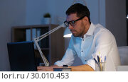 Купить «businessman with laptop working at night office», видеоролик № 30010453, снято 11 февраля 2019 г. (c) Syda Productions / Фотобанк Лори