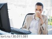 Купить «Peaceful sophisticated businesswoman drinking coffee», фото № 30011081, снято 14 мая 2013 г. (c) Wavebreak Media / Фотобанк Лори