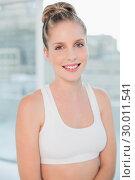 Купить «Cheerful athletic blonde posing», фото № 30011541, снято 31 мая 2013 г. (c) Wavebreak Media / Фотобанк Лори