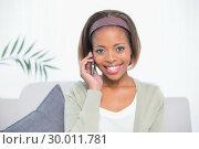 Купить «Smiling elegant woman sitting on sofa having a phone call», фото № 30011781, снято 28 мая 2013 г. (c) Wavebreak Media / Фотобанк Лори