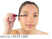 Купить «Happy woman using mascara for her eyelashes», фото № 30011889, снято 16 мая 2013 г. (c) Wavebreak Media / Фотобанк Лори