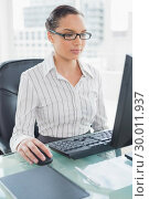 Купить «Focused businesswoman working on her computer», фото № 30011937, снято 16 мая 2013 г. (c) Wavebreak Media / Фотобанк Лори